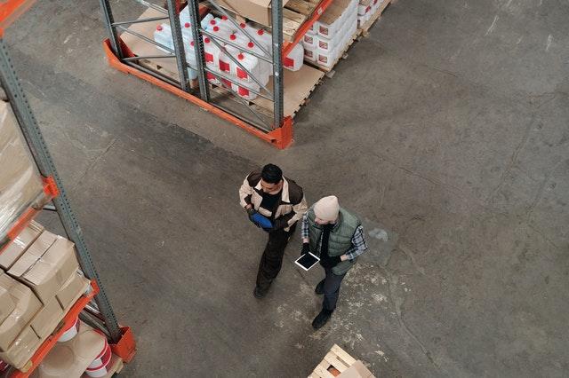 employees walking through inventory warehouse