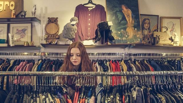 woman shopping at clothing rack