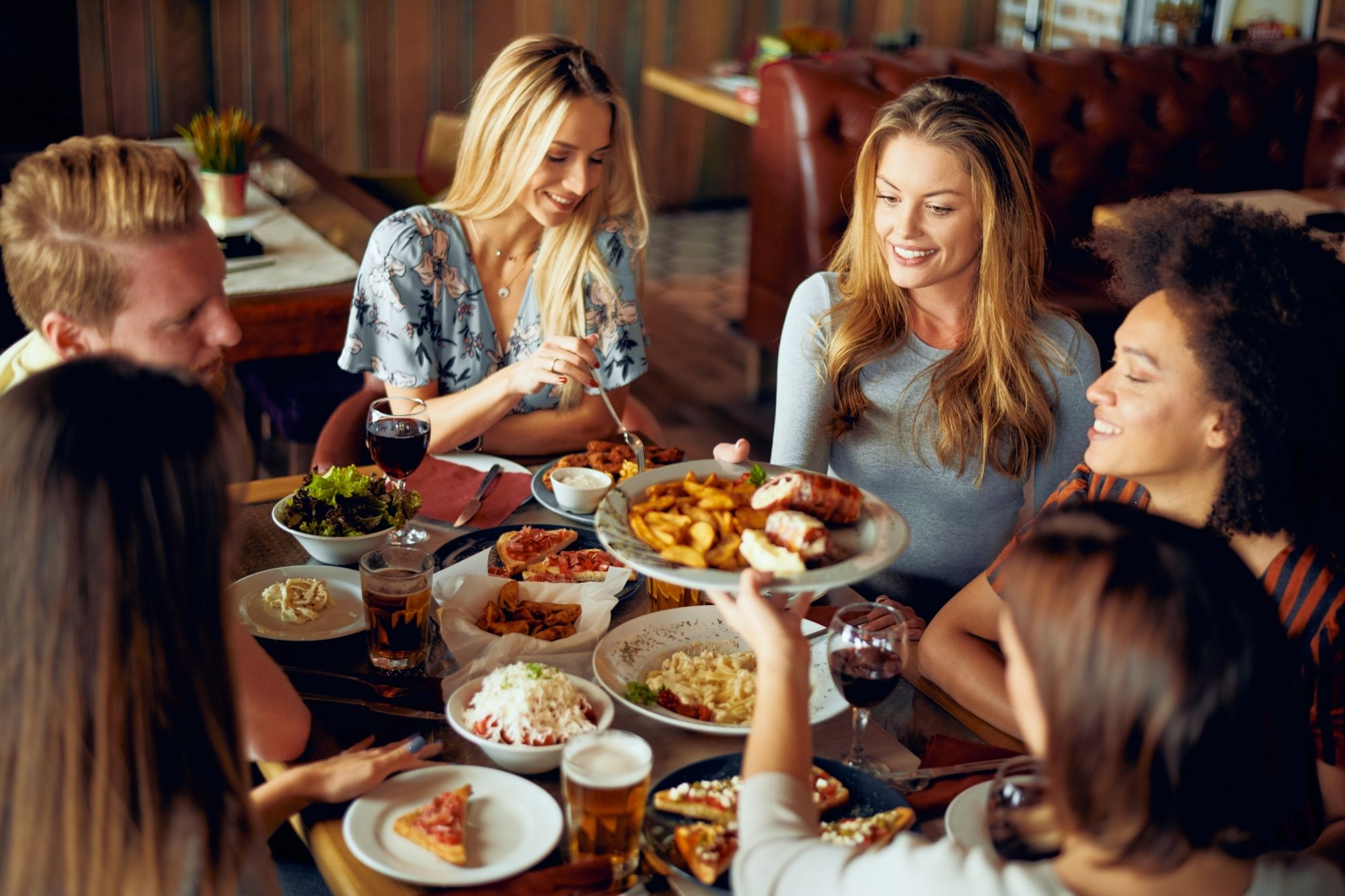 women eating food at a restaurant