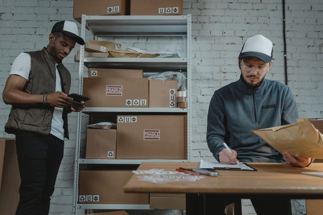two men managing inventory
