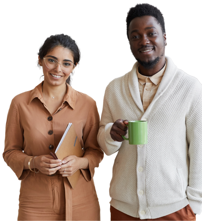 Female holding a notebook smiles next to male employee holding a coffee cup