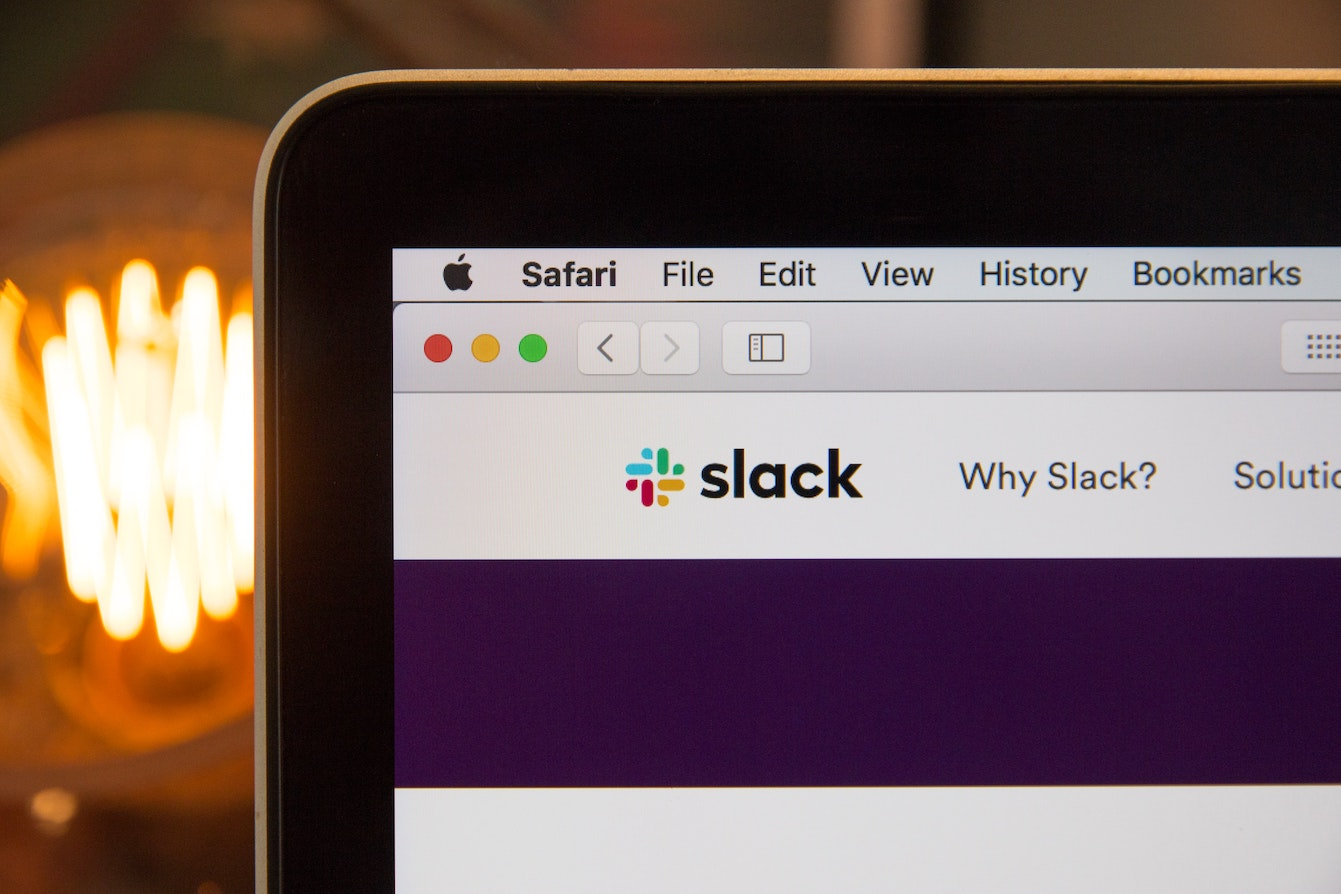 An image of Macbook screen showing Slack UI