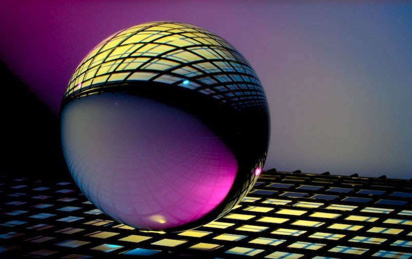 A clear glass sphere reflecting a grid