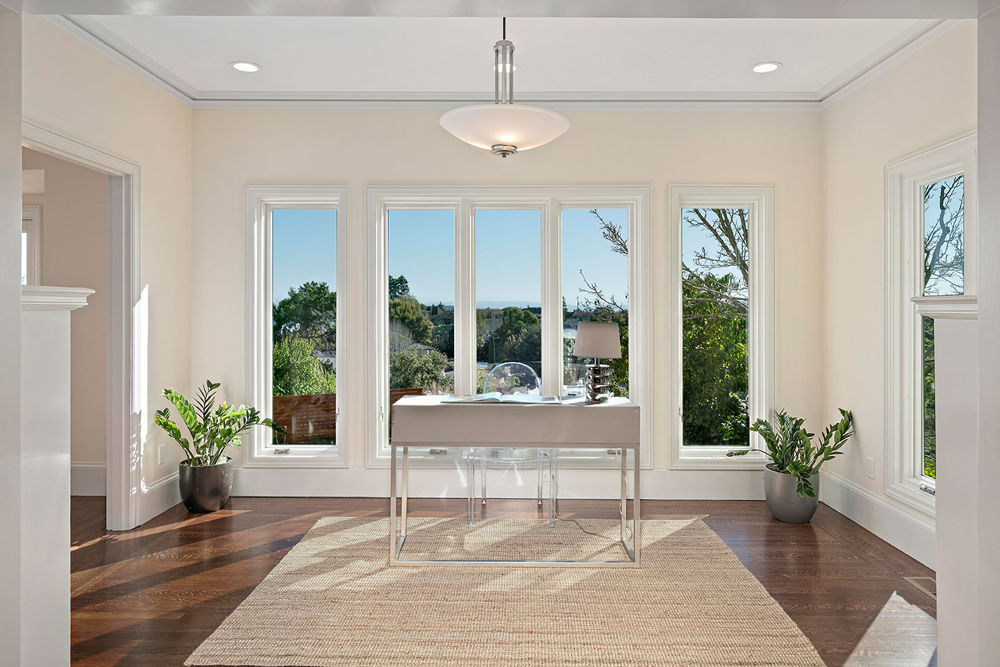 home office by bay windows