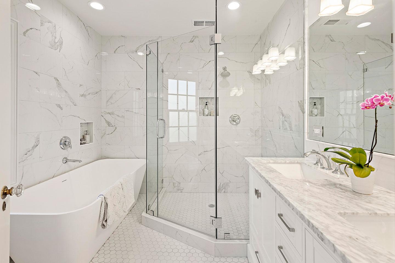 guest bathroom with hexagonal floor tile