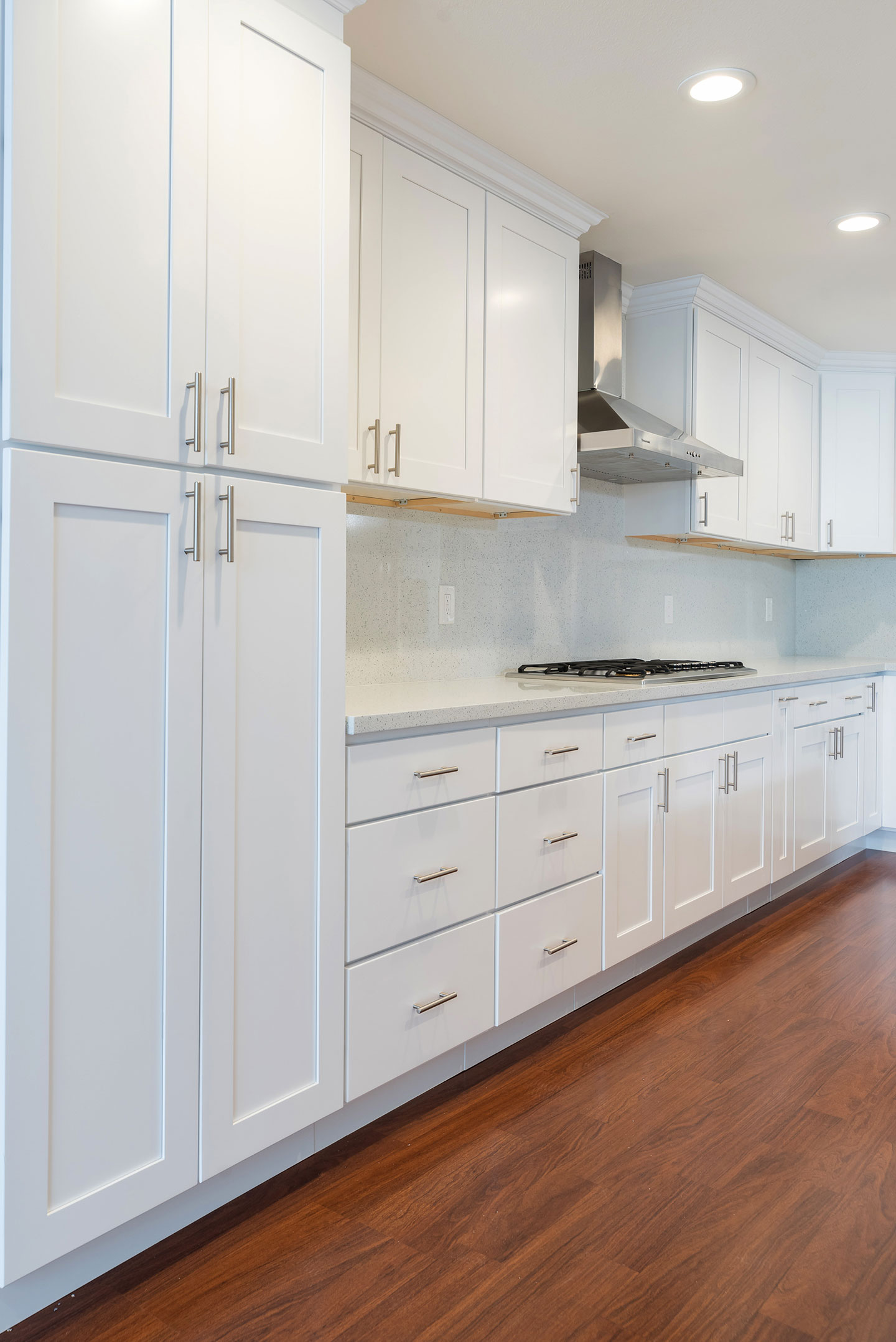 floor to ceiling cabinets with gold handles