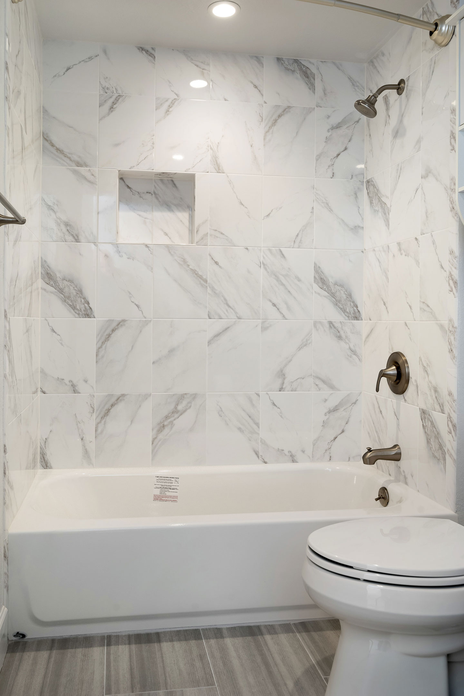 freestanding bathroom with shower area niche