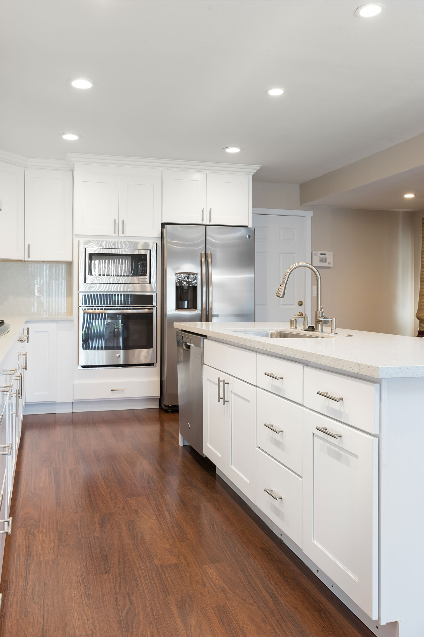 white cabinets and sandstone island