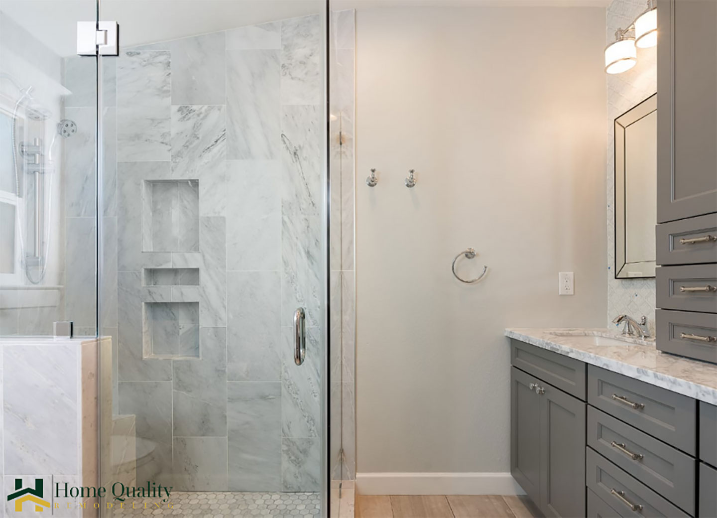 master bathroom with triple shower niche enclosed in frameless glass