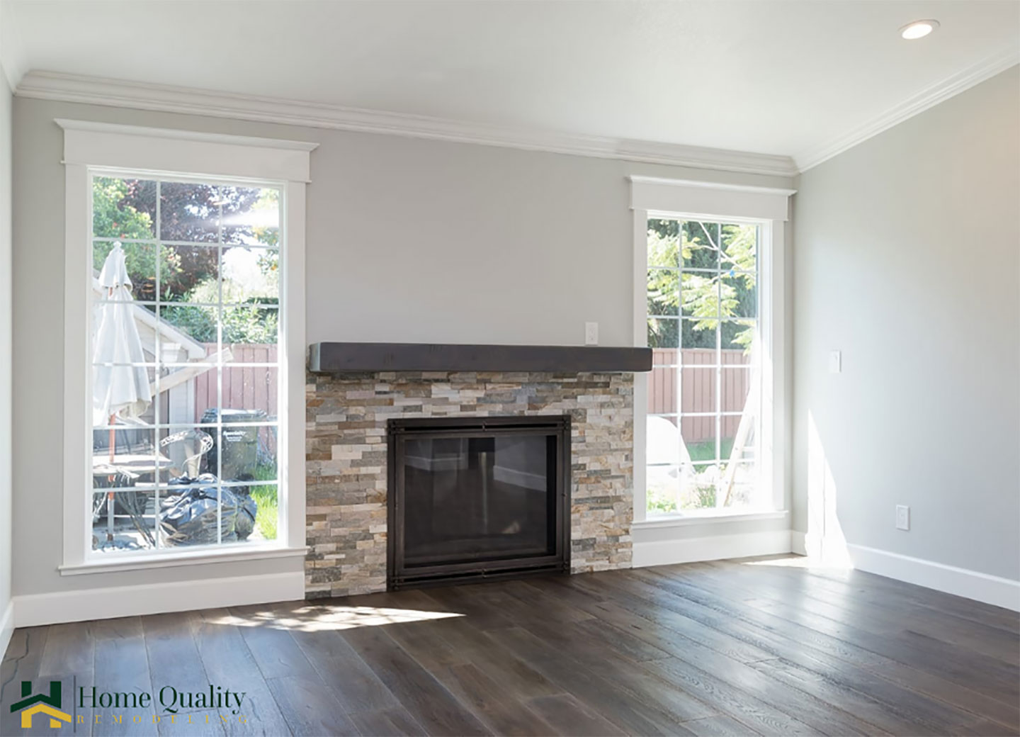 gas fireplace by double windows
