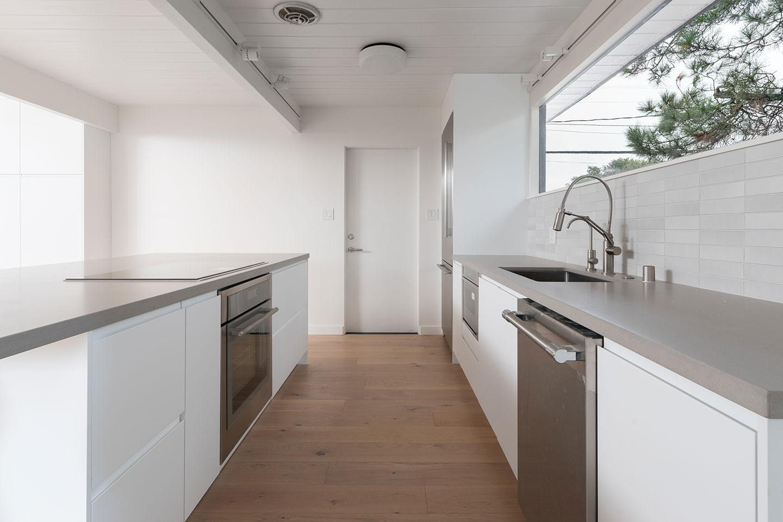 sandstone grey countertops with minimalist cabinets