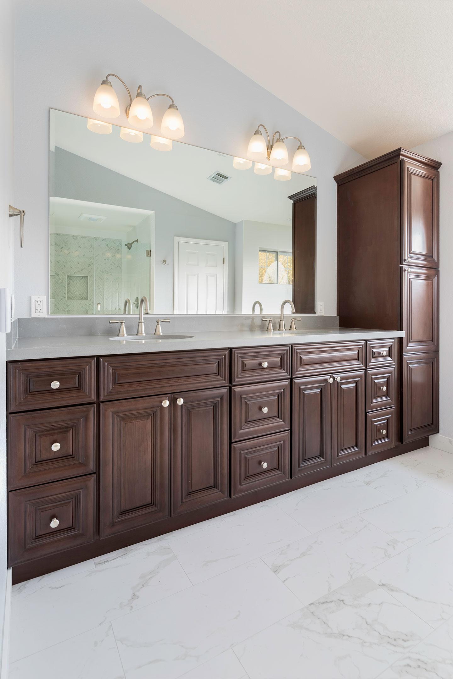 double sink vanity with dark oak drawers