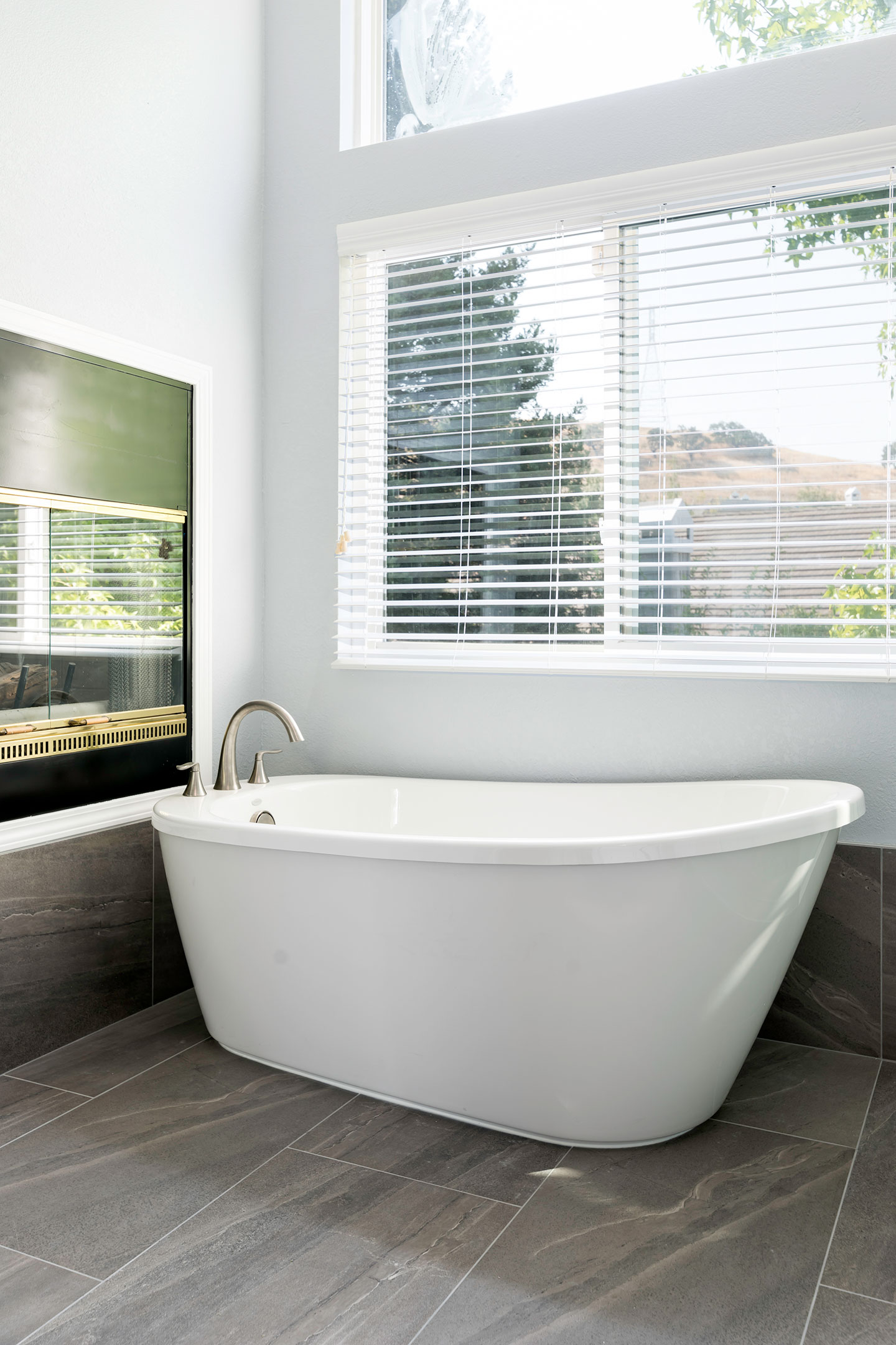 freestanding tub with a window view
