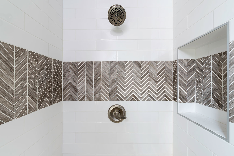 herringbone tile in shower area niche