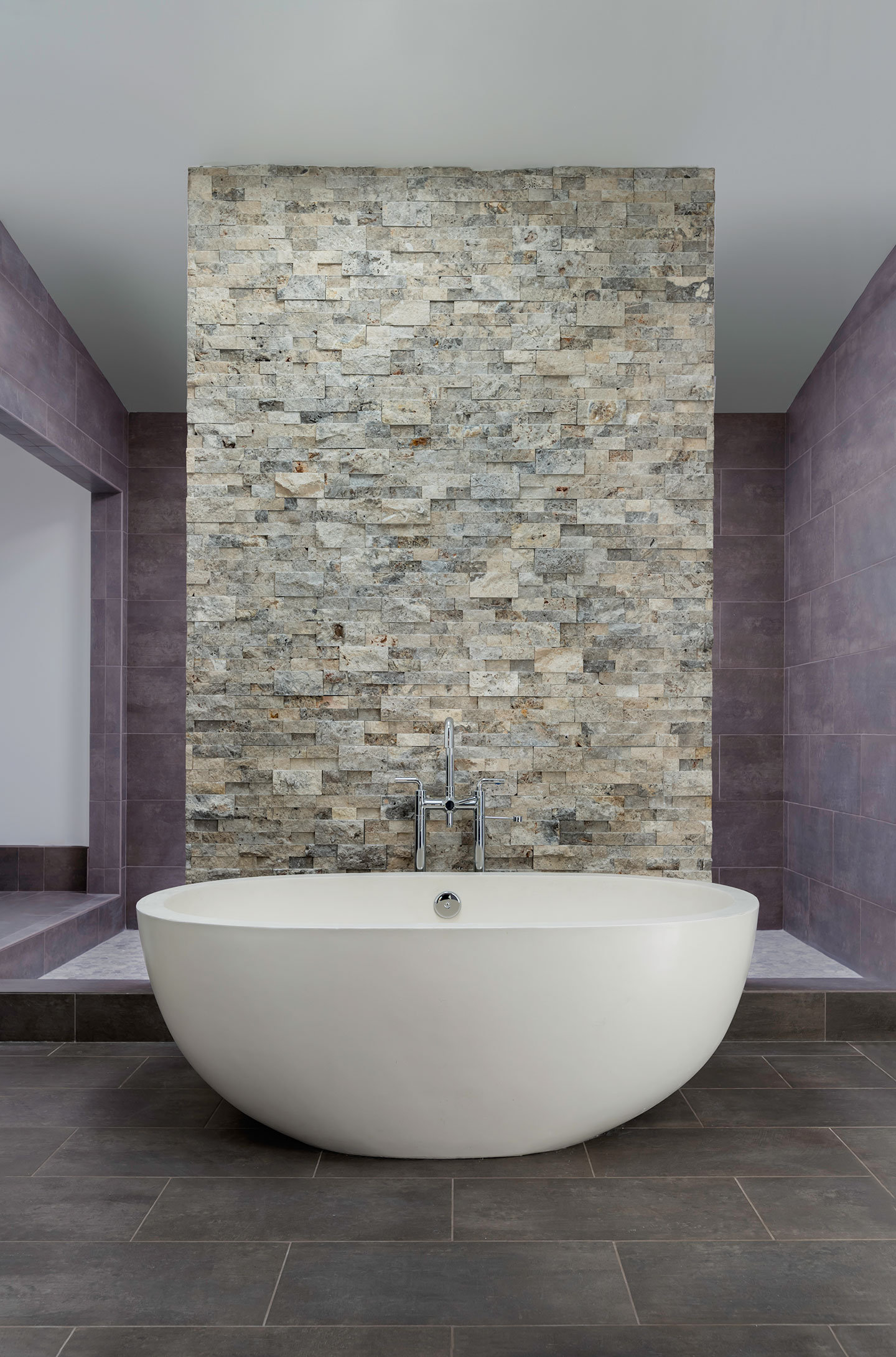 bathtub overview with tiled wall