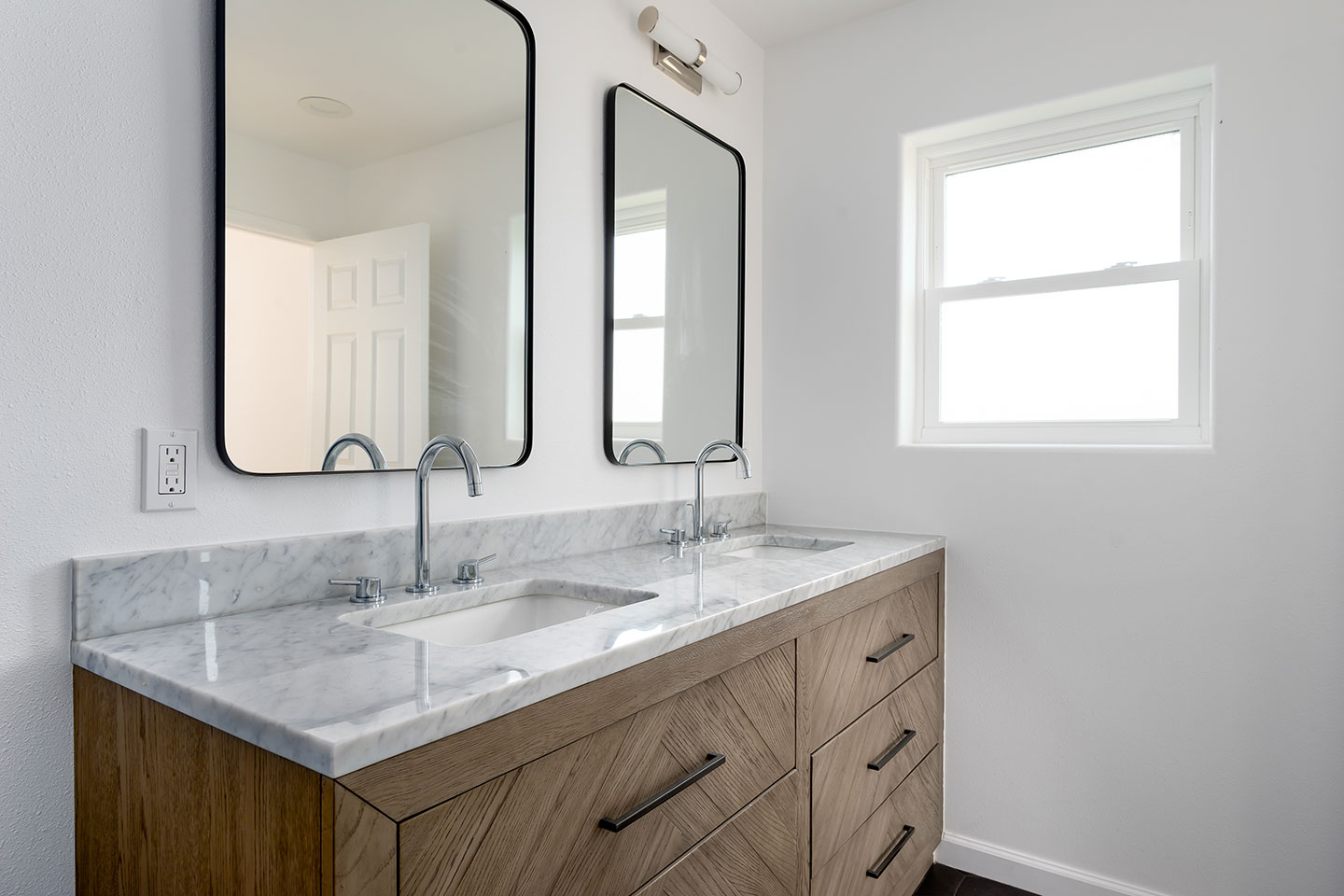 rounded corner mirrors with black accents