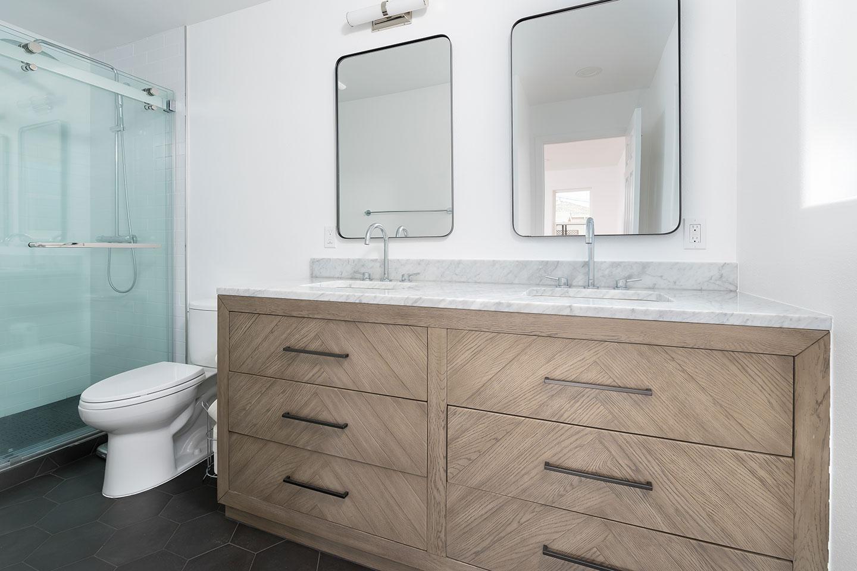 master bathroom with custom pattern drawers