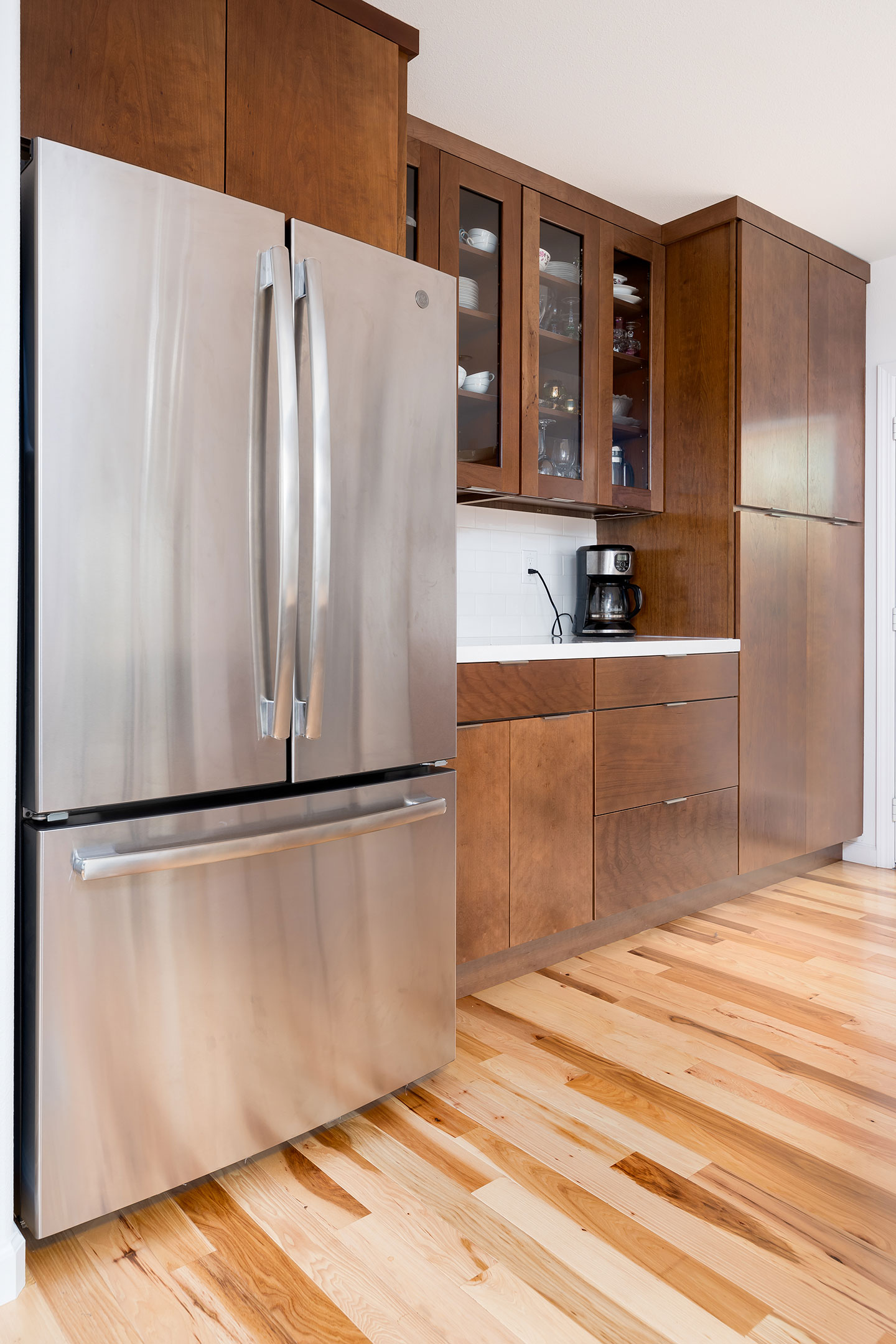 Floor to ceiling cabinets next to the coffee nook
