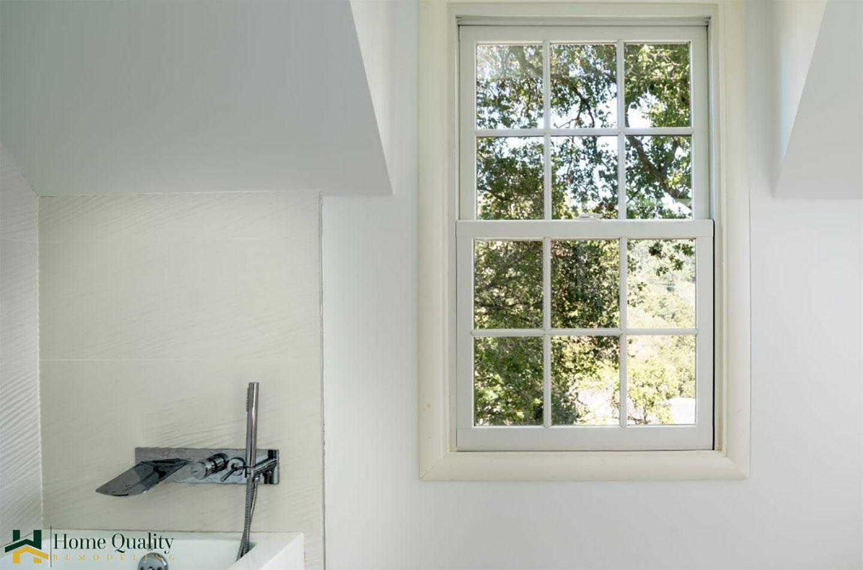 bathtub with a window view