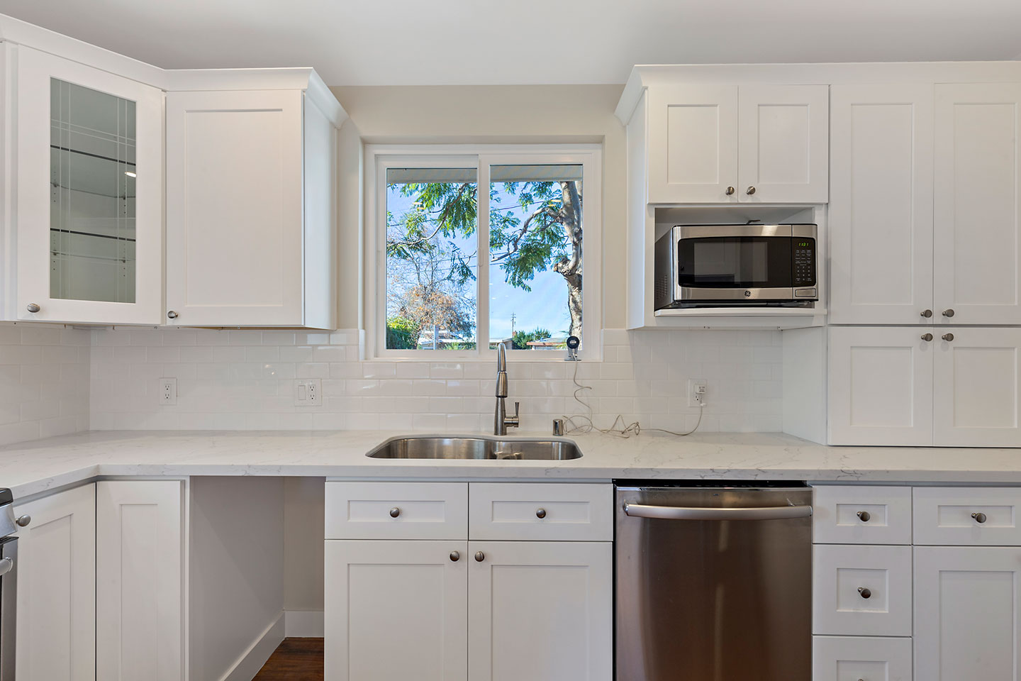 floor to ceiling cabinets with square cabinet inlays