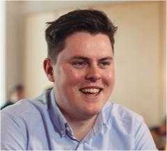 An OpenMoney Advisor Smiling