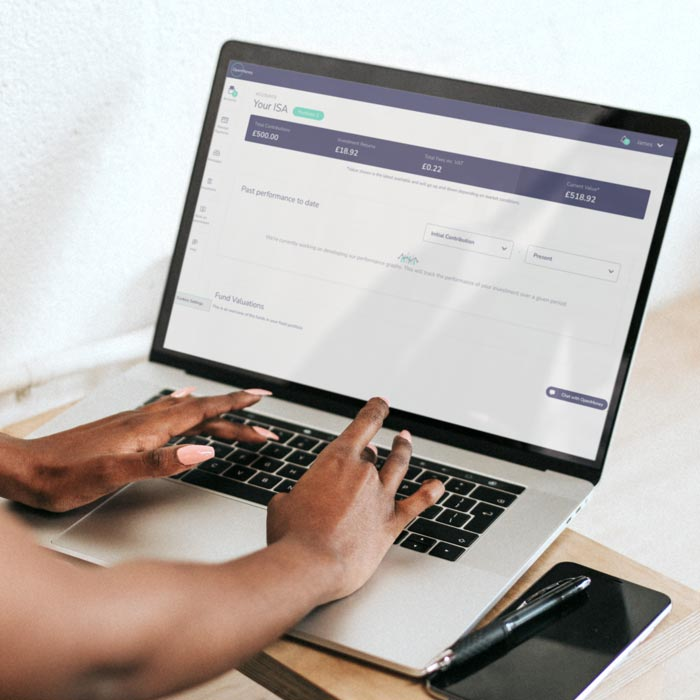 A laptop with the OpenMoney investments dashboard open