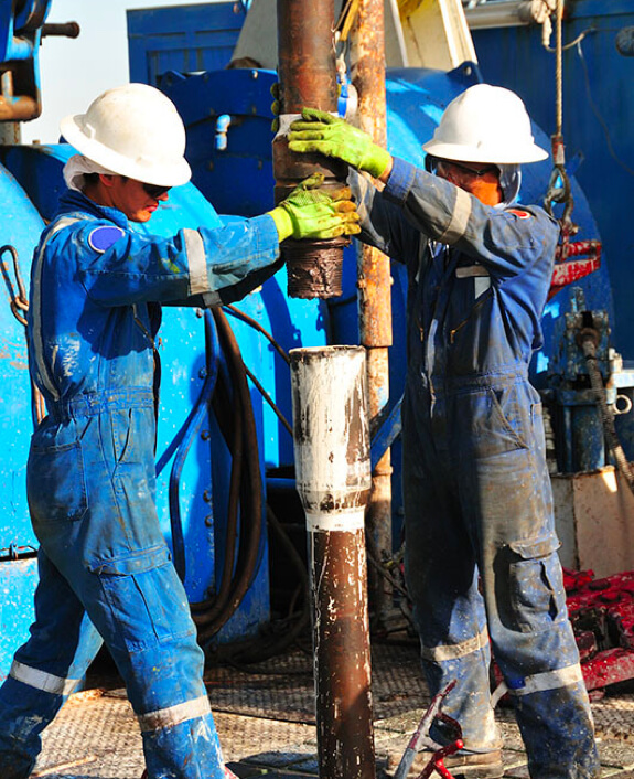 Oil Service Men Working on Drilling