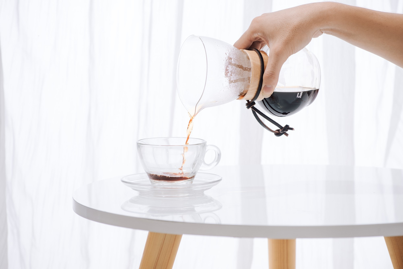 pouring brewed coffee into cup
