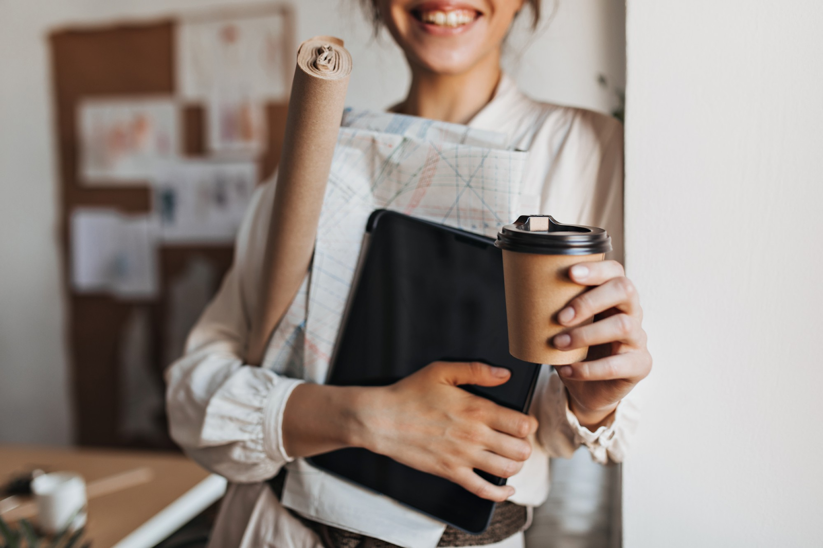 woman holding documents and her coffee