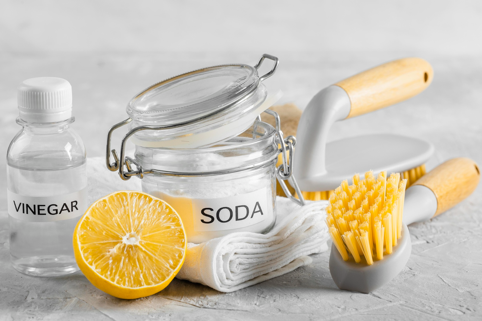 photo of vinegar and baking soda with cleaning tools