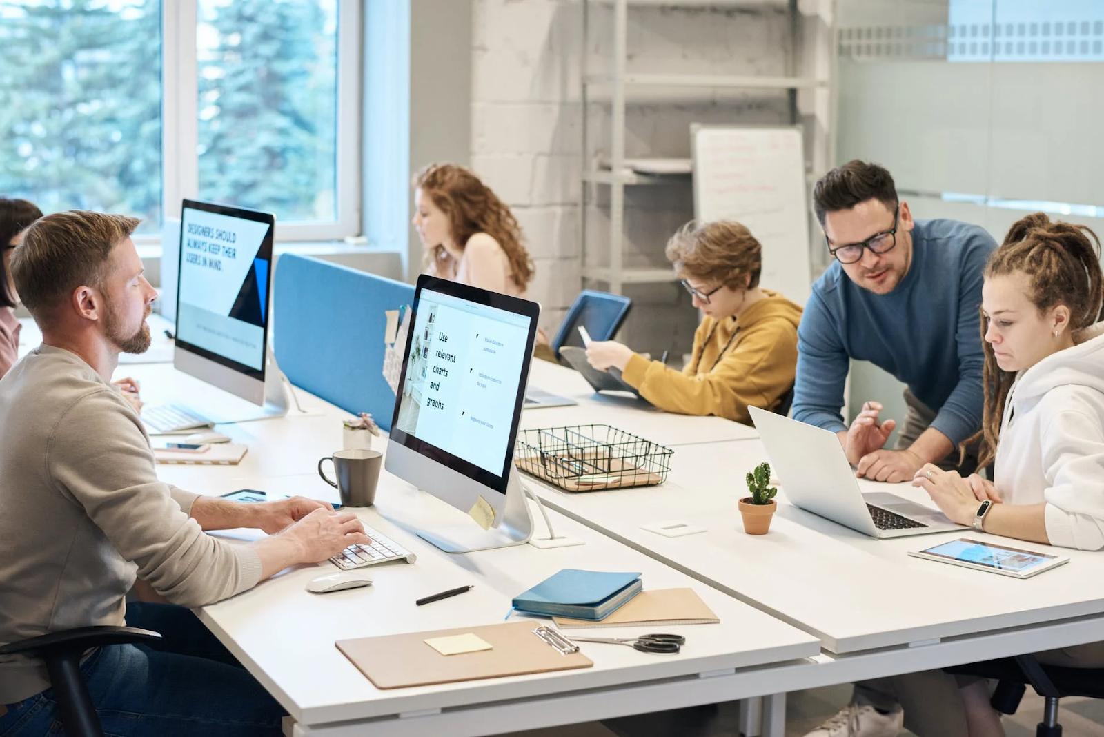 people working in front of the computer