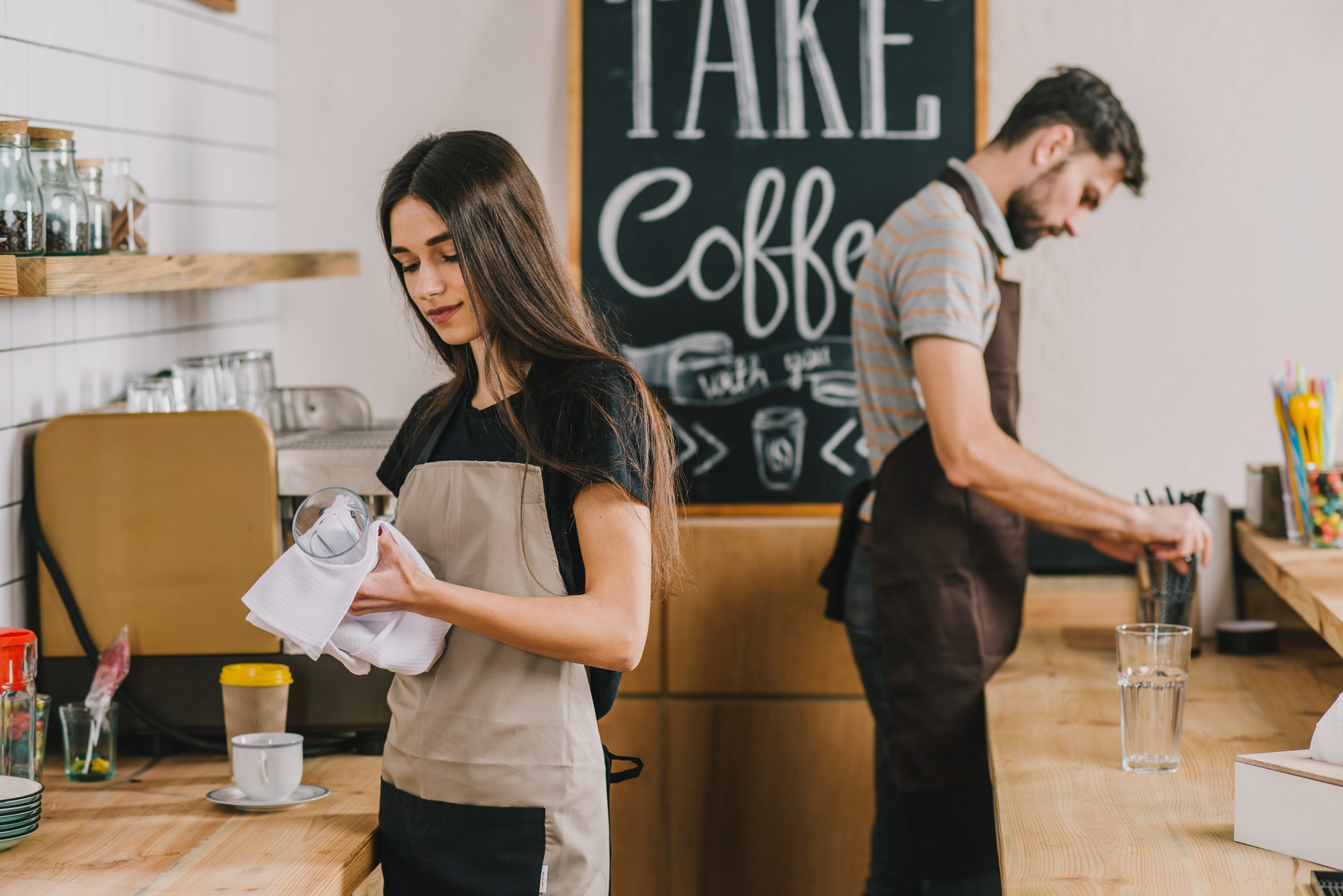 young couple operating a cafe