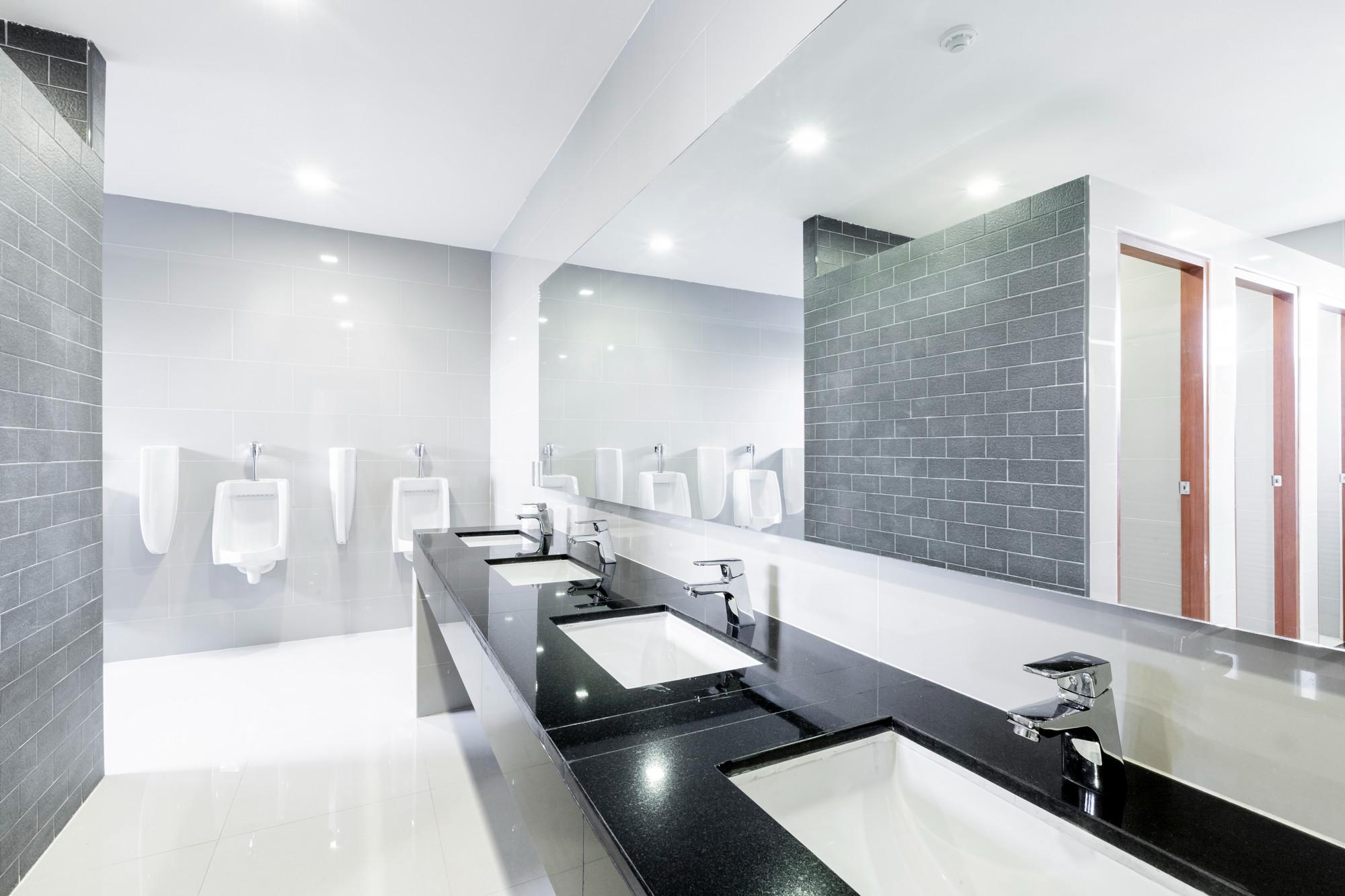 Clean bathroom with brick tiled walls