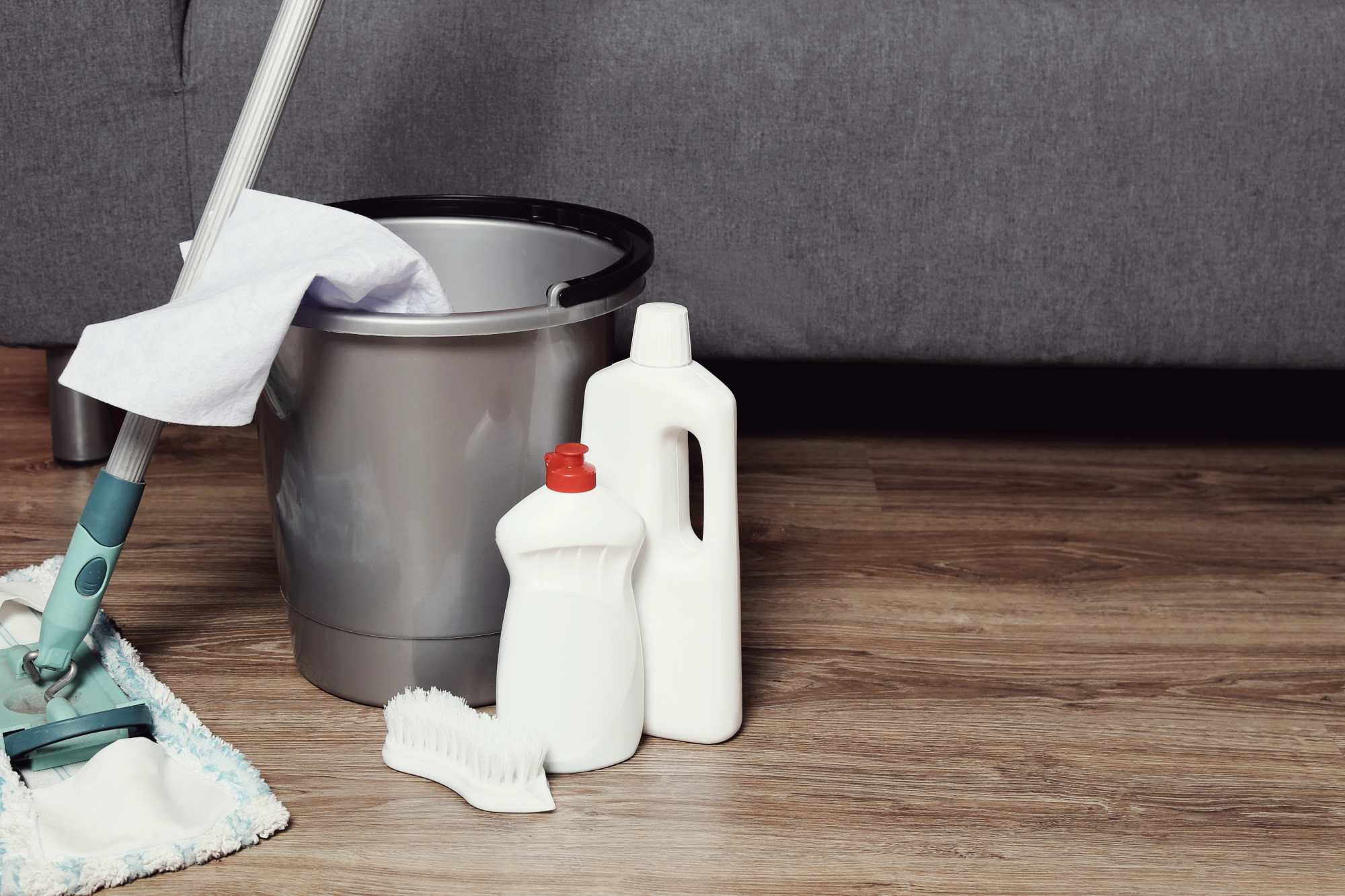 cleaning supplies on wooden floor
