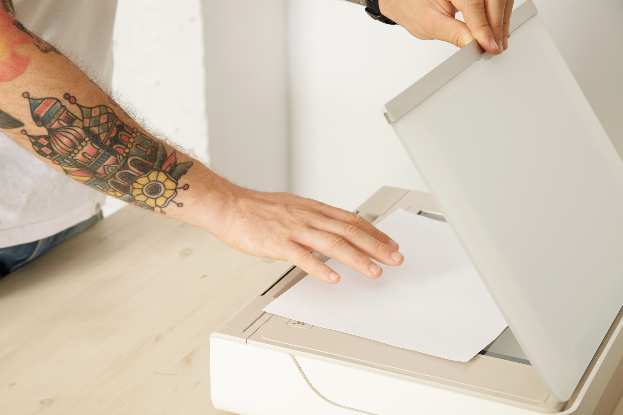 Tattooed arm using printer to scan documents