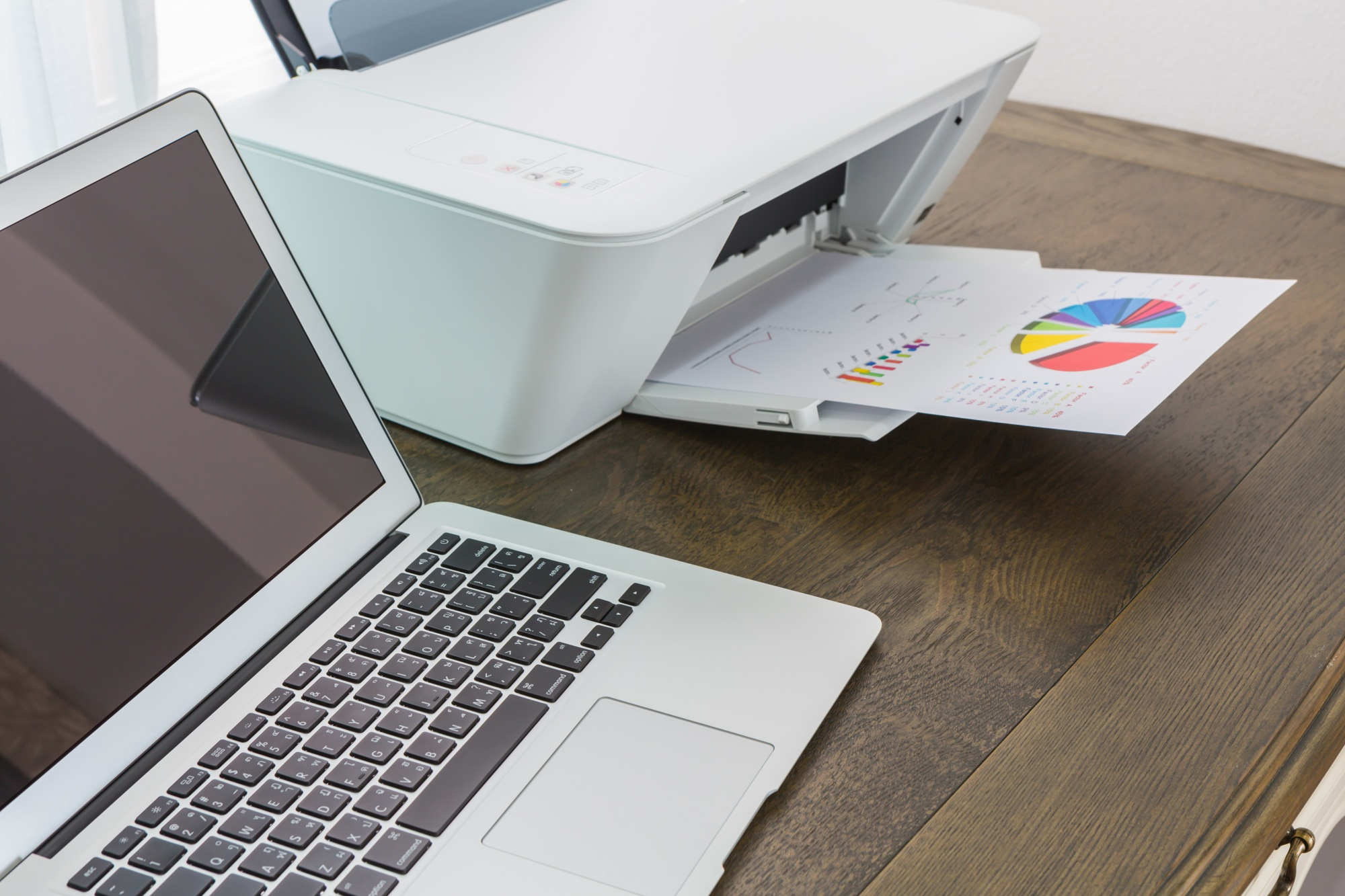 Laptop and printer on desk