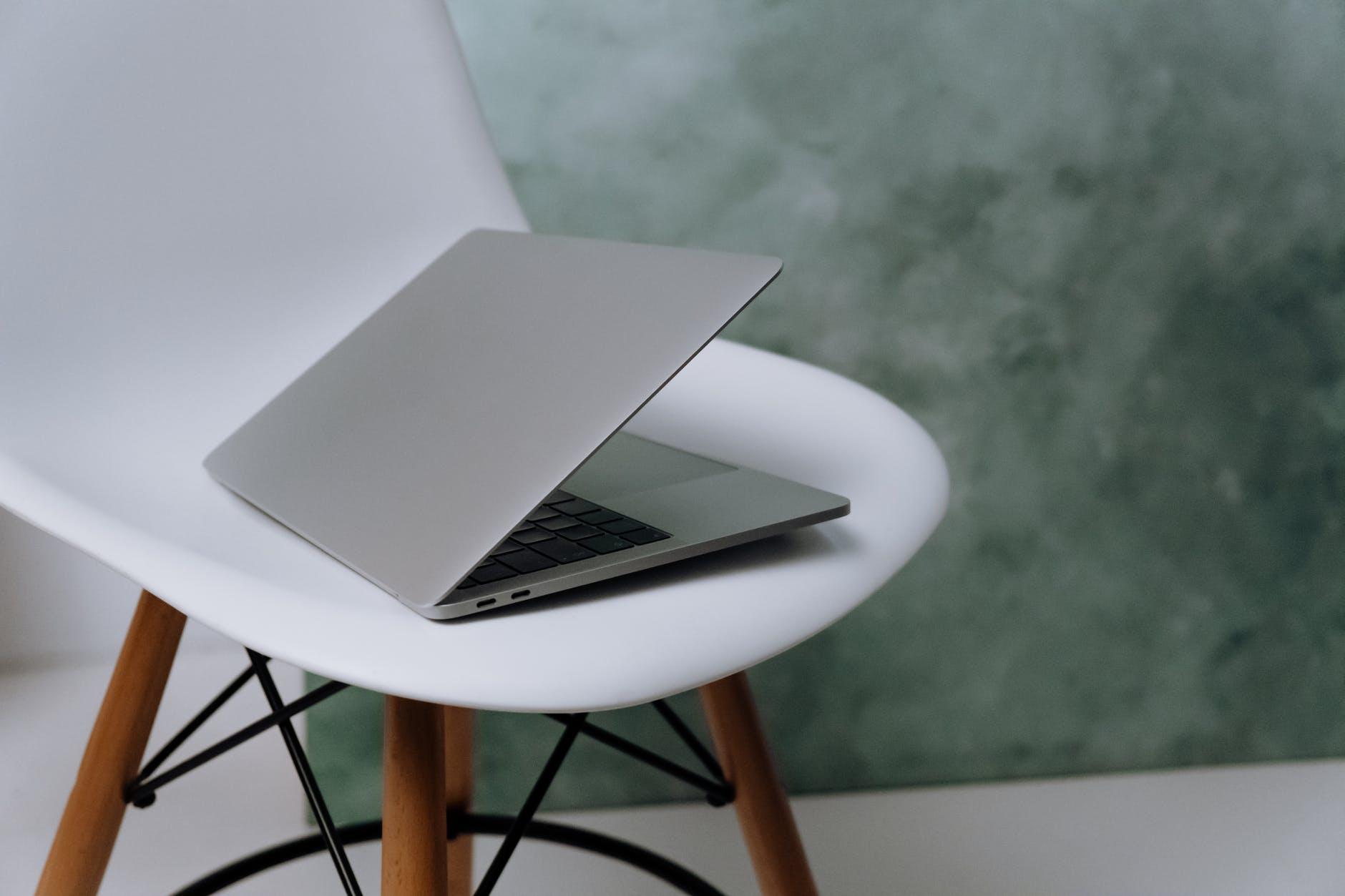 Laptop on plastic chair