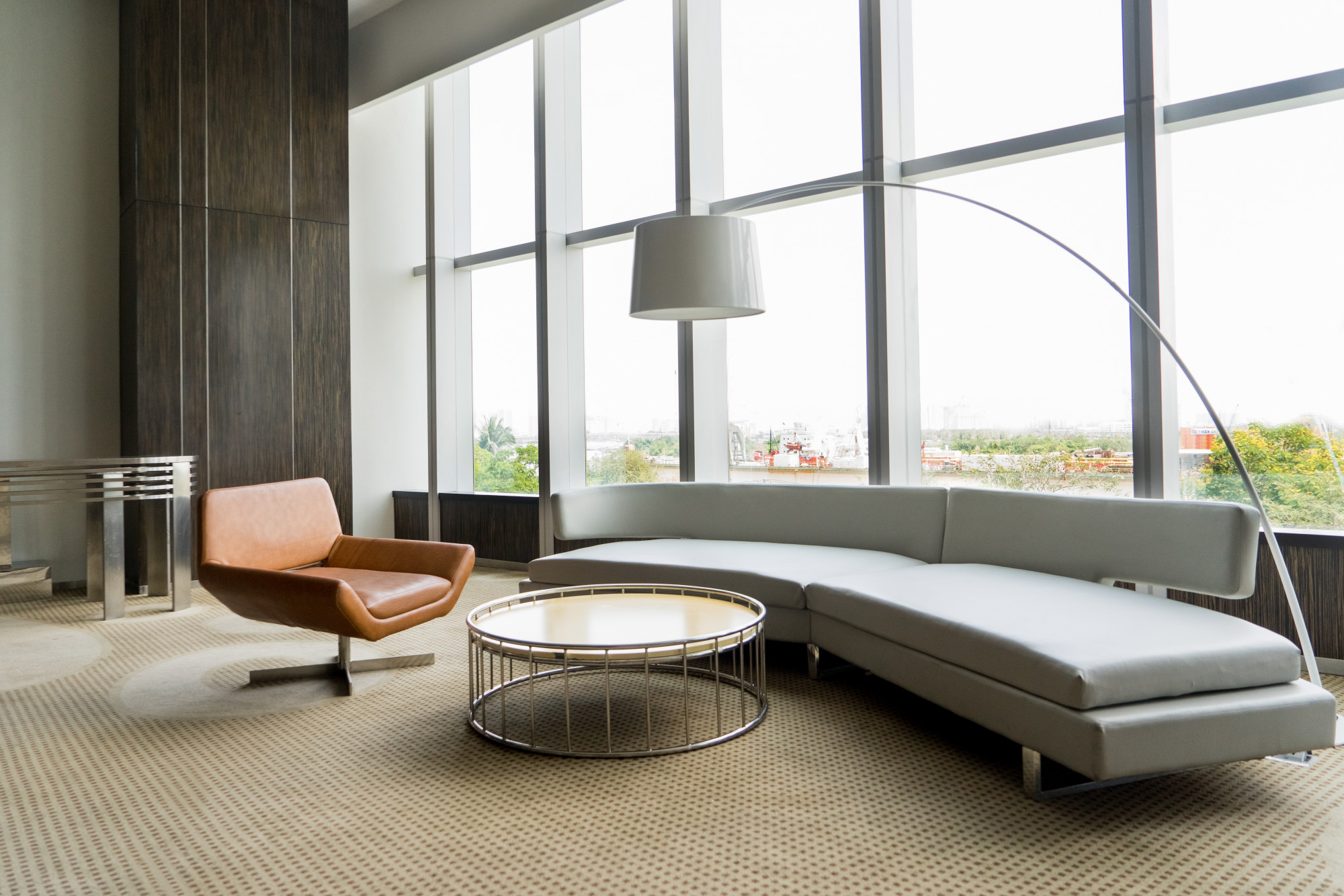 Modern office with leather swivel chair and sofa
