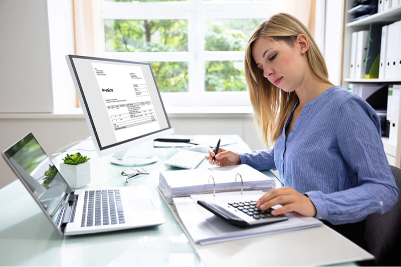 Accountant woman working on receivables factoring