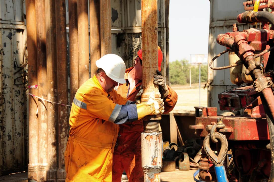 two man working on oilfield