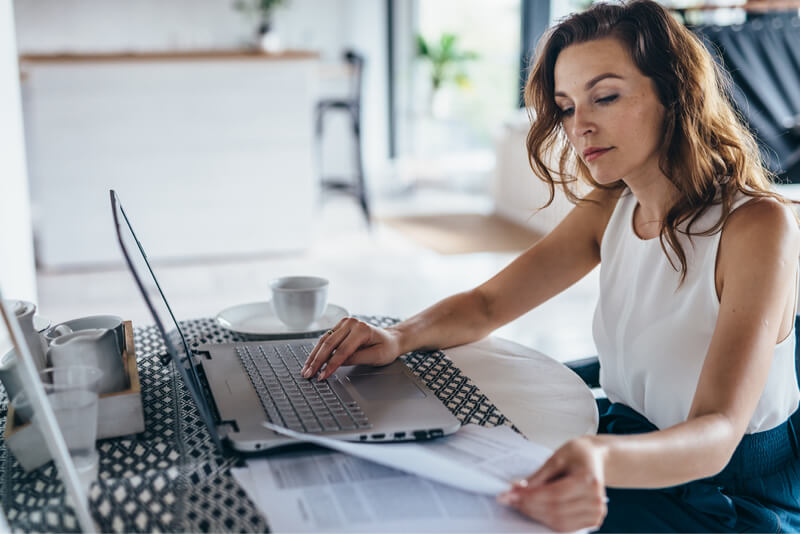 Woman on laptop inventory costs