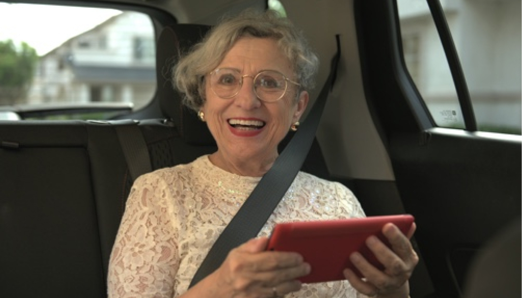 Senior riding in car with GrandPad