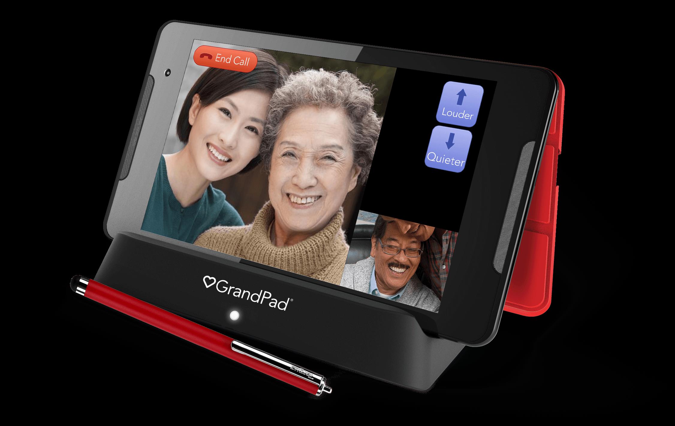 GrandPad tablet displaying Home Screen in charging cradle