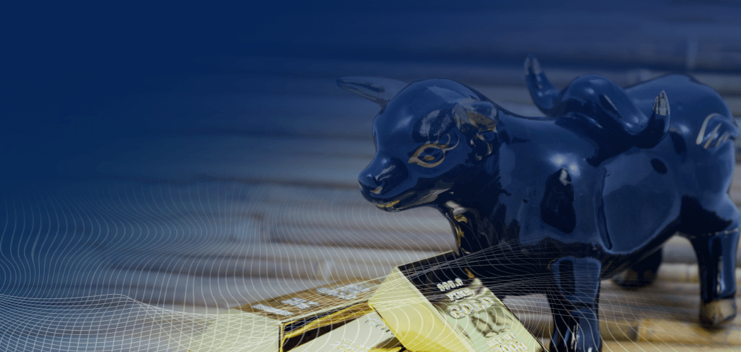 Wall Street bull table statue and gold bars on a table
