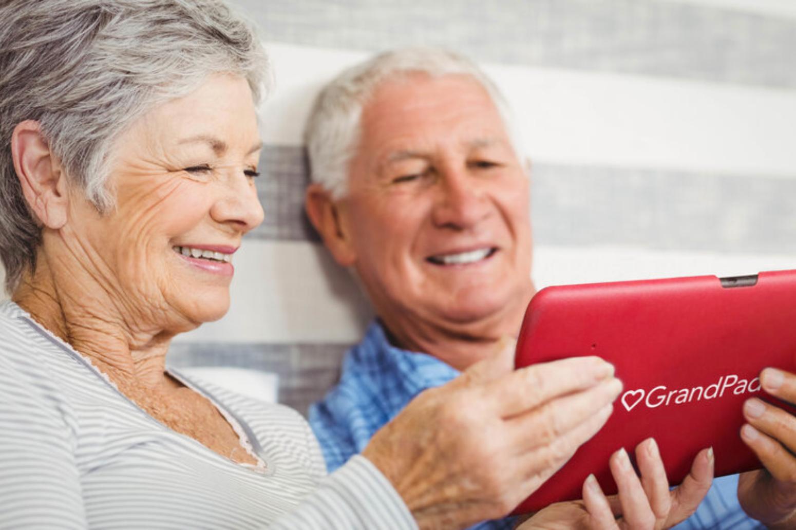 Senior couple enjoying a grandpad video call