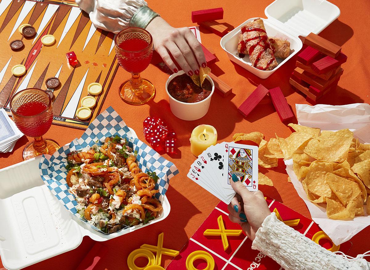 Tiki Taco game night with asada curly fries, churros, chips and salsa, and Jarritos.