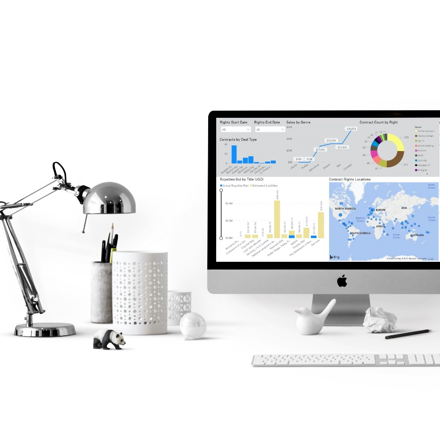 computer on desk displaying Business Intelligence Manager