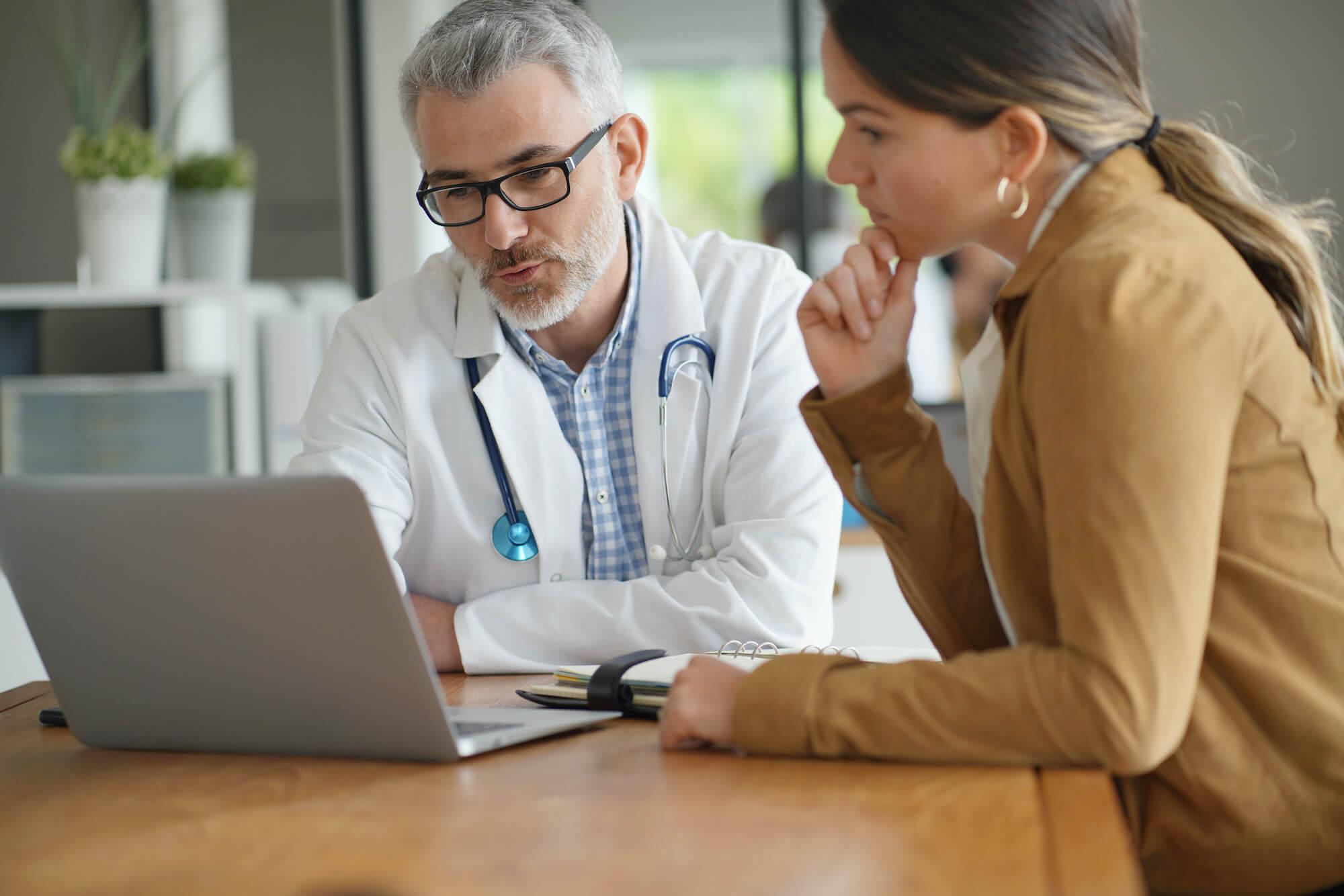 doctor reviewing patient