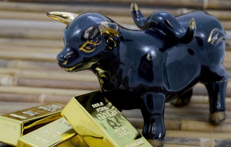 Bull statue with gold bricks