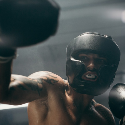 black male with black boxing gloves
